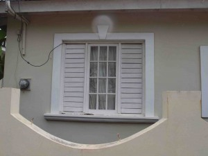 Double hung window with side louvers, Falmouth, Jamaica.
