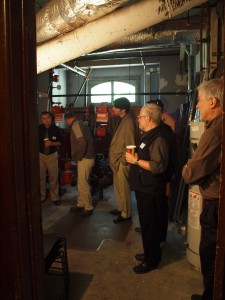 Examining the historic furnace in the Haas-Lilienthal House