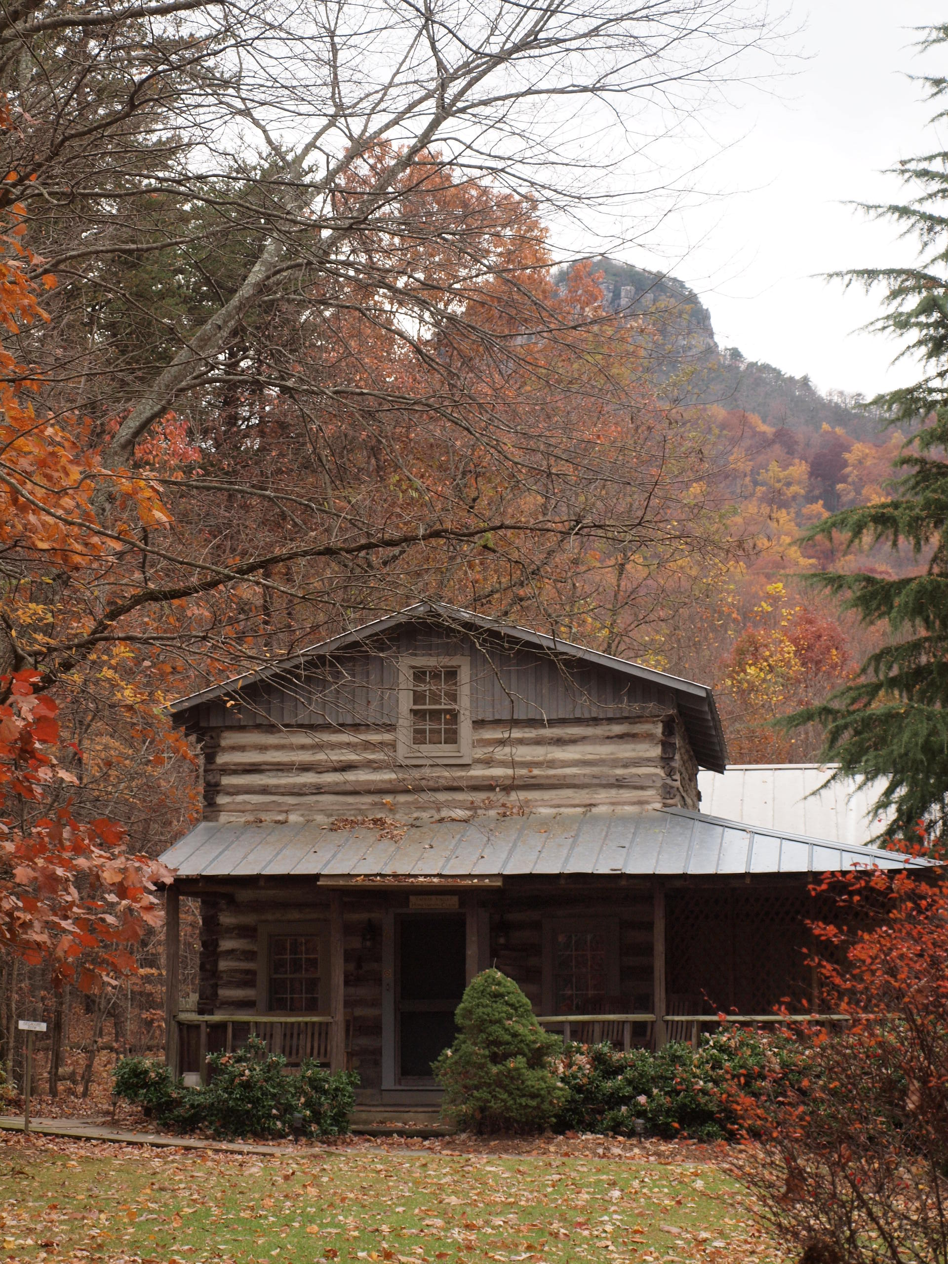 Log stone cabins cottages homes in out on for Rustic log cabin homes