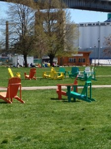 A great view of the grain elevators, Adirondack chairs and vibrancy of Canalside.