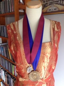 I keep my AIA Fellow's Medal (left) and Dean's Medal from the University at Buffalo School of Architecture & Planning on my manikin which wears my antique evening gown.