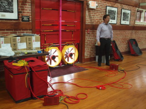 Setting up the whole building blower door test, 2nd floor historic gymnasium space, Lee H. Nelson Hall.