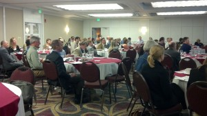 Conference participants gather in the Radisson Hotel ballroom on Day One.