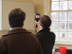 Marcus Eliason from Apollo BBC studies energy loss in the Lee H. Nelson Hall with the assistance of an infrared  tool.