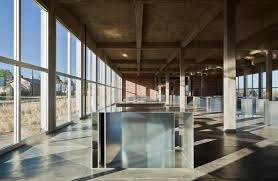 The artillery shed which houses Donald Judd's art. Are the windows art as well?